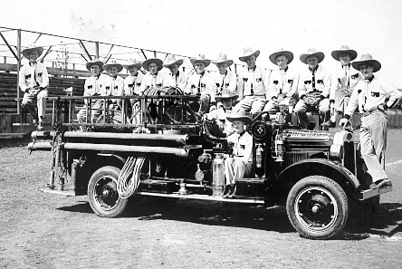 A black and white photo of an rarly Molalla Fire engine