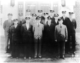 A black and white photo of early Molalla firefighters