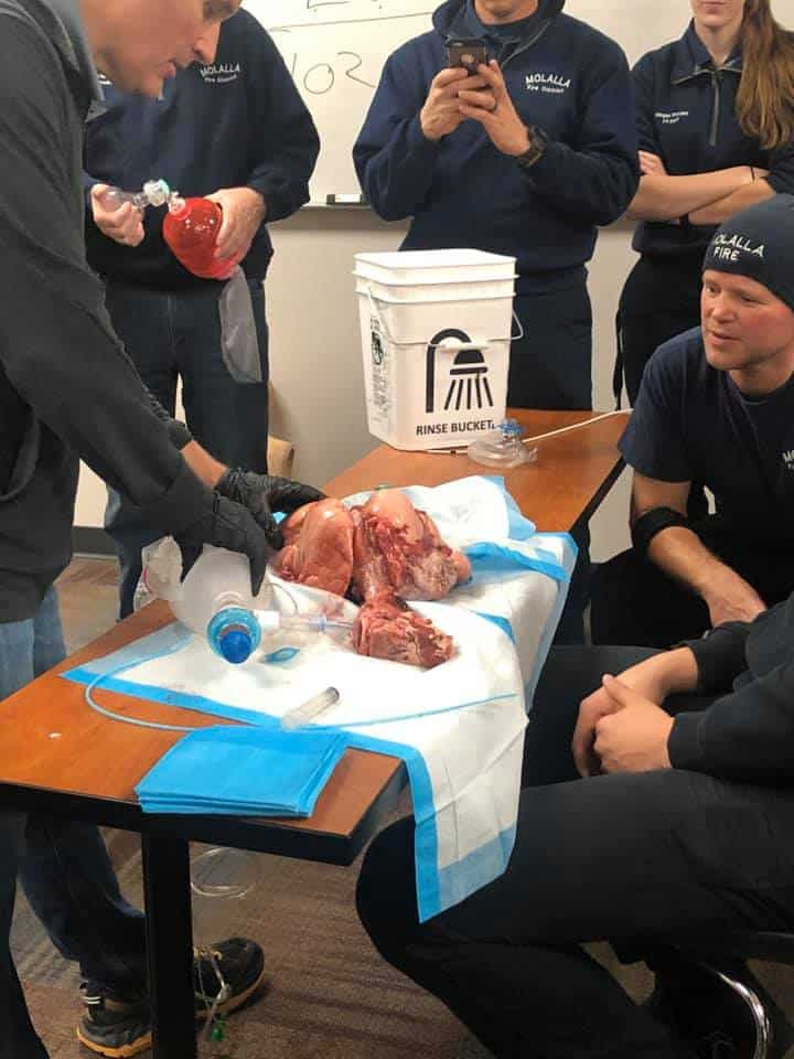 EMS volunteers train on advanced airway placement.