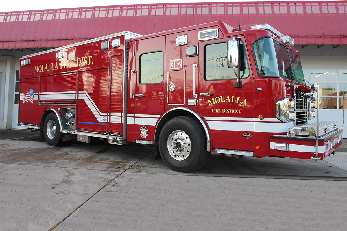 Engine 382 parked in front of the bay doors