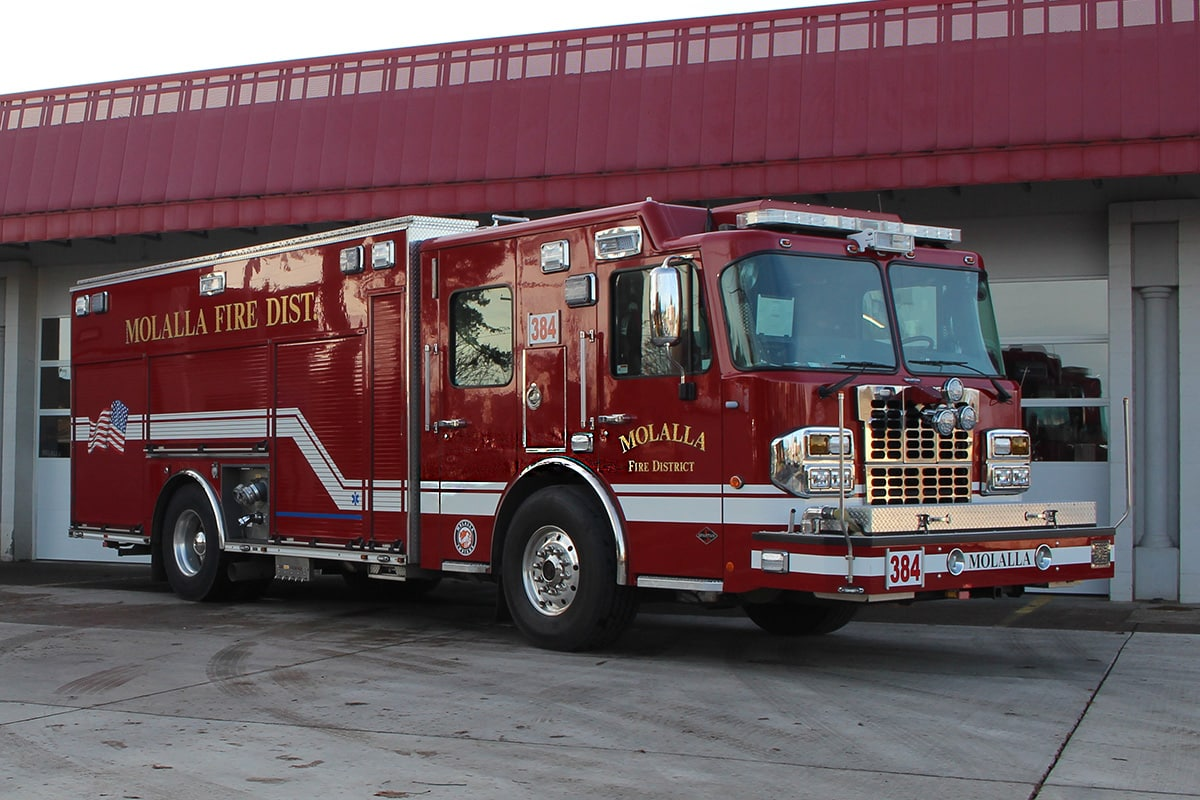 Engine 384 parked in front of the bay doors