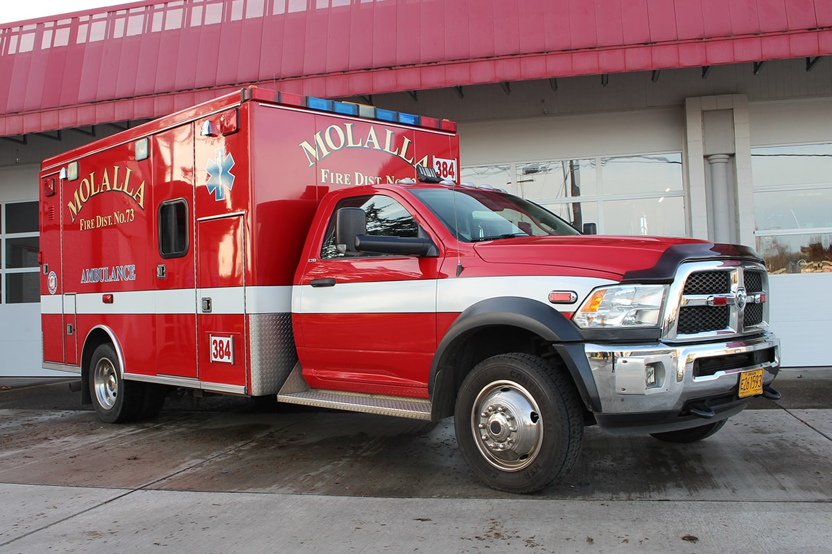 Medic unit 384 parked in front of the bay doors