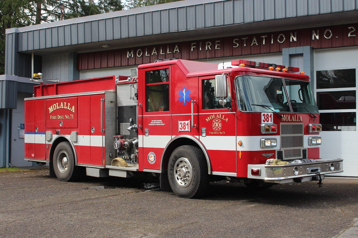 Engine 381 parked in front of the bay doors