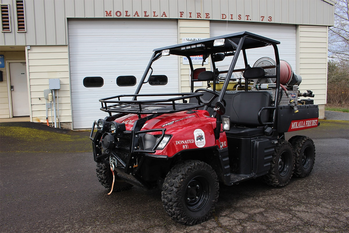 Special Rescue 382 (a UTV) parked in front of the bay doors